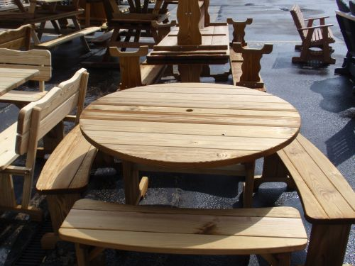 Wooden outdoor tables from amish swings things round picnic table with banana benches 54 30600 watchthetrailerfo